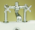 Strom Plumbing - P0802C Polished Chrome Deck Mount Tub Fill Only Faucet with Metal Cross Handles. The P0802 cross handles have porcelain buttons for hot and cold.
