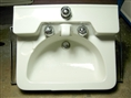 This is a genuine, original Crane Drexel Porcelain Wall Mounted Sink from the 1950's. This is a very unique wall hung sink with built-in porcelain spout, slant-back mount Dial-Ease faucet, built in soap recess and half-moon shaped bowl.