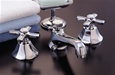 Strom Plumbing - P0152C Mississippi Polished Chrome Plated Widespread Lavatory Faucet with Cross Handles and Pop-Up Drain. Cross handles have porcelain button for hot and cold.