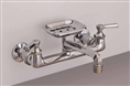 Strom Plumbing P1047 - Wall Mount Kitchen Faucet with 6-inch Swivel Spout and Lever Handles.